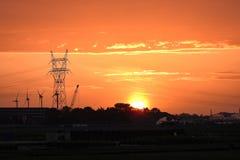 与橙色天空的美好的日落 库存照片