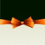 与橙色弓的节假日背景 库存照片