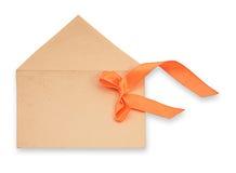 与橙色磁带的信包在一个空白背景 免版税库存图片