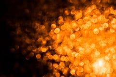 与橙黄火的抽象背景飘动圈子 圣诞节与圈子的抽象背景 免版税库存照片