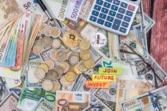 与欧元和美金、硬币和计算器的Cryptocurrency 免版税库存图片