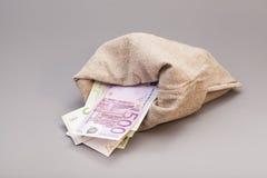 与欧元的金钱袋子 免版税库存图片