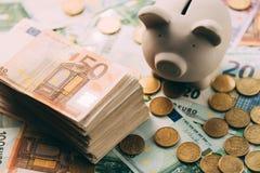 与欧洲现金的贪心moneybox 免版税库存照片