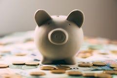 与欧洲现金的贪心moneybox 免版税库存图片