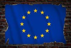 与欧盟旗子的海报在砖墙上 免版税库存照片