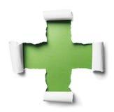 与正形状的白色被撕毁的纸在绿色 免版税库存照片