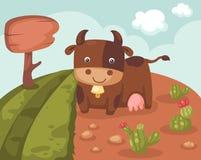 与母牛的小山风景 免版税库存图片