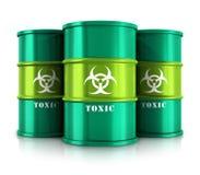 与毒性物质的绿色桶 免版税库存照片