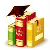 与毕业盖帽的书 库存图片