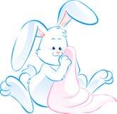 与毯子的兔宝宝 免版税库存照片
