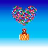 与气球心脏的熊 免版税库存照片