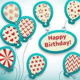 与气球的生日快乐减速火箭的明信片。 图库摄影