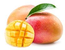 与水下落的芒果果子 在一个空白背景 库存图片