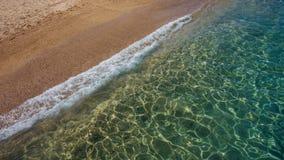 与沙子和海的海滩 库存照片
