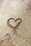 与沙子的爱 免版税库存图片