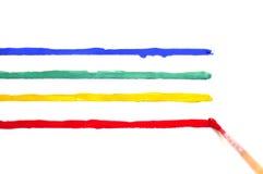 与油漆和色的条纹的刷子 免版税库存图片