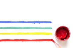与油漆和色的条纹的刷子 图库摄影
