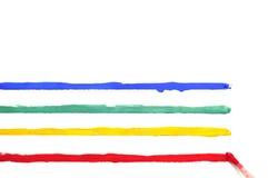 与油漆和色的条纹的刷子 免版税库存照片