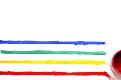 与油漆和色的条纹的刷子 库存照片