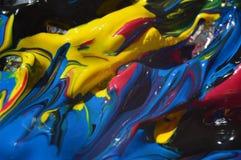 与油漆的抽象背景在不同美丽弄脏 库存照片