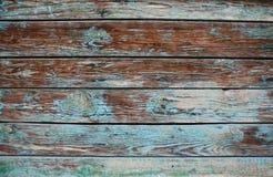 与油漆镇压和层数的老破旧的木背景  库存图片