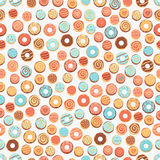与油炸圈饼的无缝的背景 免版税库存图片