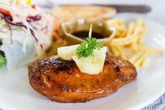 与油煎的法语的鸡牛排 图库摄影