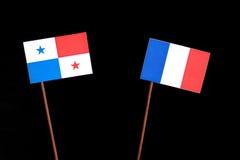 与法国旗子的巴拿马旗子在黑色 库存照片