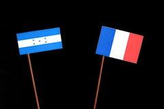 与法国旗子的洪都拉斯旗子在黑色 库存图片