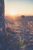 与泛光灯和背后照明的大气日落颜色 库存图片