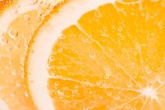 与泡影的橙色果子背景 图库摄影