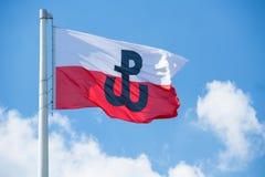 与波兰战斗的标志的波兰旗子 库存照片