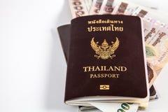 与泰国金钱的泰国护照和释放左空间 免版税库存照片