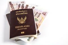与泰国金钱的泰国护照和释放正确的空间 图库摄影