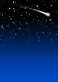 与流星尾巴的简单的蓝色繁星之夜天空背景 免版税图库摄影