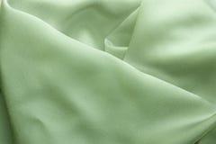 与深温暖的颜色的被折叠的织品 免版税库存图片