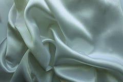 与深温暖的颜色的被折叠的织品 库存照片