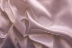 与深温暖的颜色的被折叠的织品 库存图片