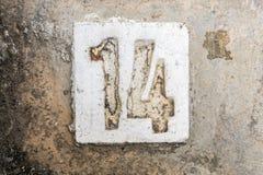 与混凝土的数字在边路14 免版税库存照片