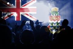 与混和开曼群岛旗子的实况音乐音乐会在爱好者 库存照片
