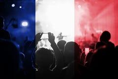 与混和法国旗子的实况音乐音乐会在爱好者 免版税库存照片