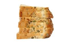 与混杂的种子的切的面包 库存图片