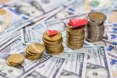 与滴漏和美元的欧洲硬币 库存照片