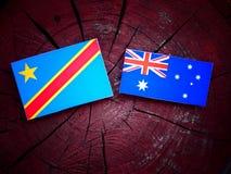 与澳大利亚旗子的刚果民主共和国旗子在树桩 免版税库存图片