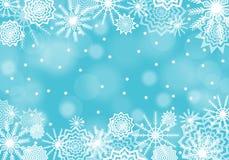 与火光和闪闪发光的绿松石落的雪背景 雪花摘要 库存照片