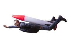 与火箭力量的亚洲商人飞行隔绝了白色backg 库存照片