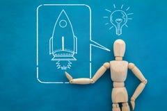 与火箭图画的木人形象 JPG 免版税库存图片