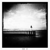 与灯塔的码头 免版税库存图片