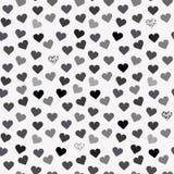 与灰色心脏的无缝的背景样式 免版税库存照片