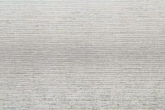 与灰色银色表面效应的织地不很细纸背景 免版税库存图片